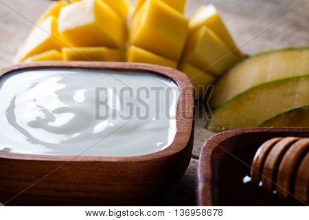 Fresh yogurt honey and mango for shake.