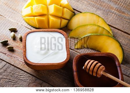 Ingredients for preparation the Indian specialty mango lassi.
