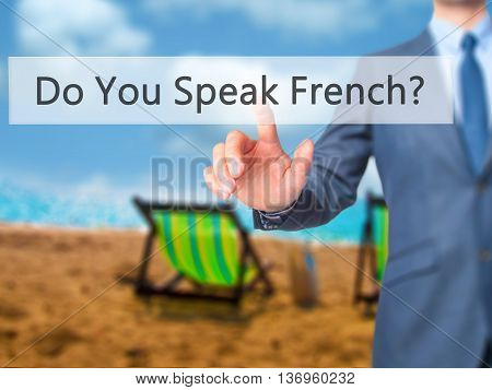 Do You Speak French ? - Businessman Hand Touch  Button On Virtual  Screen Interface