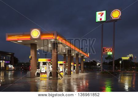 DALLAS Tx USA - APR 17 2016: Shell gas station with a 7 eleven shop illuminated at night. Dallas Texas United States