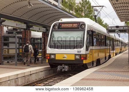 DALLAS Tx USA - APR 18 2016: Dallas Area Rapid Transit (DART) train arriving at the station