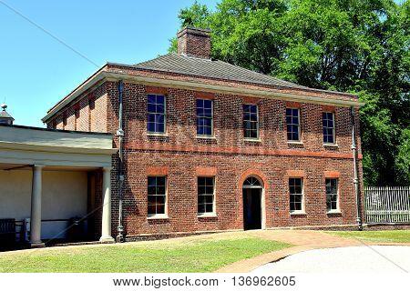 New Bern North Carolina - April 24 2016: Georgian brick Stables Wing at historic 1770 Tryon Palace
