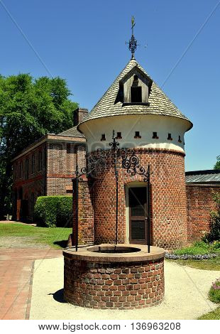 New Bern North Carolina - April 24 2016: Drinking water well and dovecote behind the Stables wing at 1770 Tryon Palace