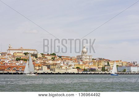 View of the national Pantheon and the convent of São Vicente de Fora from the Tagus river at Alfama in Lisbon Portugal