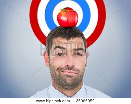 Businessman looking at the camera against grey vignette