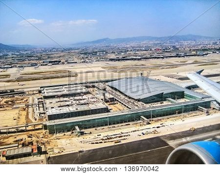 Barcelona Spain - July 9 2008: View over airport Barcelona with runways and terminals - aerial view from airplane during take off