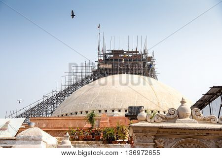 Boudhanath stupa under reconstruction after the major earthquake on 25 April 2015. Boudhanath is one of famous place in Nepal and the largest ancient stupa in the world.