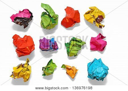 Crumpled color paper folded in a row. Crumpled paper isolated on white