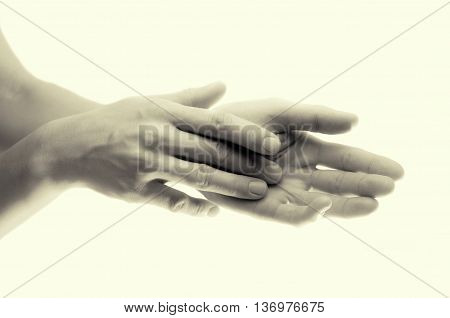 Beautiful female hands cloce up b/w isolated on toned background