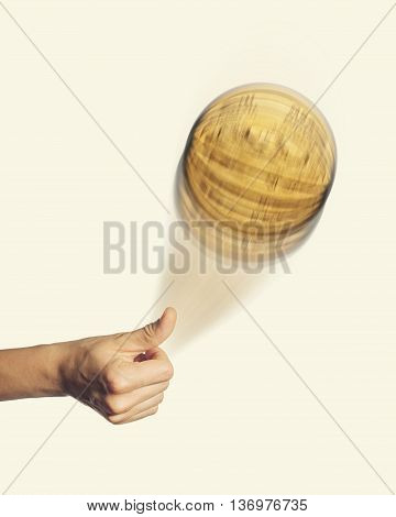 Person hand throwing up a coin to make a decision isolated on toned background