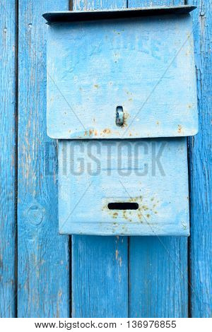 Blue Painted Metal Retro Postbox On Wood