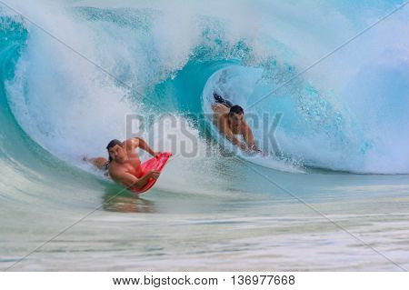 Boogie Boarder in the pipe as the wave breaks over him. Sandy Beach Oahu HI June 17 2016