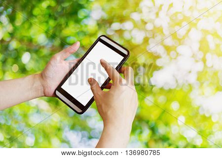 Hand Woman Using Phone In Garden With Bokeh And Sunlight.,