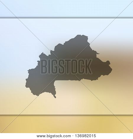Burkina Faso map on blurred background. Blurred background with silhouette of Burkina Faso.