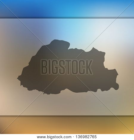 Bhutan map on blurred background. Blurred background with silhouette of Bhutan.