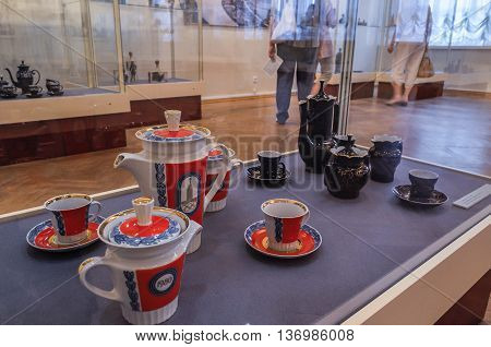 VELIKY NOVGOROD RUSSIA-JULY 1 2016. Exhibition of Chinaware in the traditional Russian style at the Museum of Fine Arts and unidentified visitors walking and looking the exhibits