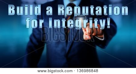 Business coach is pressing Build a Reputation for Integrity! on a virtual touch screen. Business and industry metaphor. Motivational concept and call to action. Torso of man in blue suit.