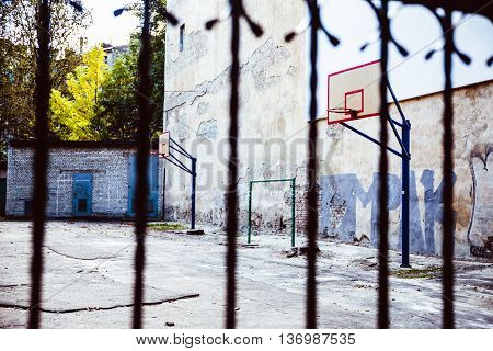 abandoned Basketball court backyard with concrete floor