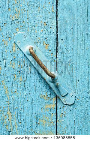 Old Metal Door Hande On Flaking Wood