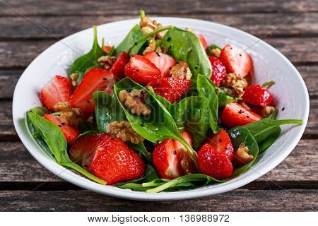 Summer Fruit Vegan Spinach Strawberry nuts Salad. concepts health food.