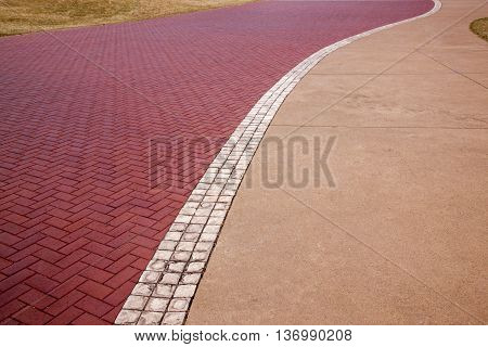 Red Paved  Patternes And Textures On Beach Front Promenade
