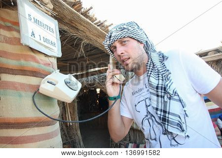 Man With Fake Phone In Sahara