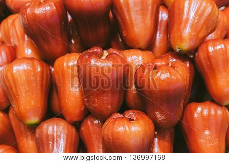 Pile of rose apples background close up image