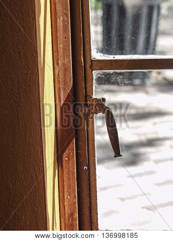 The side of a window showing a latch.