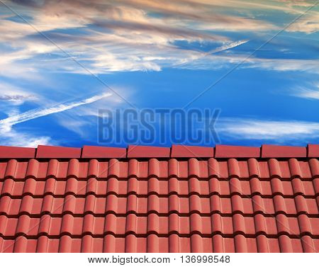 Roof tiles and sunset sky with sunlight clouds