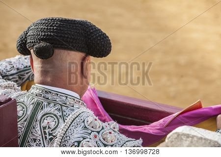 Ubeda Spain - October 2 2010: Detail of Pigtail in the XIX century the bullfighters were left to grow a ponytail that braided in a bun called moña vague recollection of the times of the wigs of the XVIII century in the Bullring of Ubeda Spain