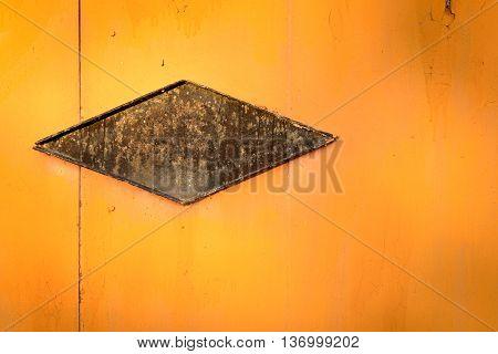 Abstract Metal Shape On Orange Sheet