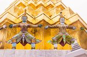 """Demon Guardian at the Emerald Buddha temple or """"Wat Phra Kaew"""" , Bangkok, Thailand. It is landmark and well-known destination for most tourists. poster"""