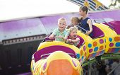 Kids on a thrilling roller coaster ride at an amusement park  poster