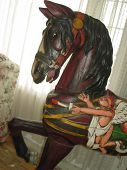 a painted carousel horse poster