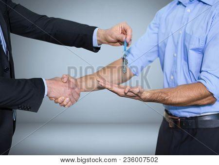 Men holding keys handshake in front of vignette