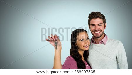 Couple Holding key in front of vignette