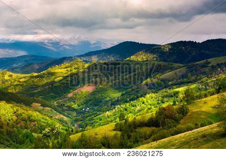 Springtime In Mountainous Countryside. Lovely Rural Landscape With Forested Hills And Agricultural F
