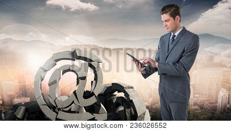 Broken concrete stone with at symbol and businessman in cityscape