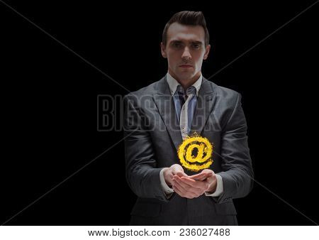businessman with hands spread of with at sign fire icon over. Black background