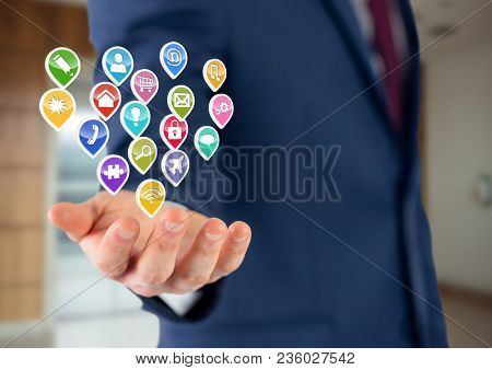 businessman with hand spread of with application icons over. office blurred background