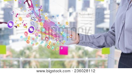 woman with hand spread of with application icons with pink and blue lights coming up form it. Blurr