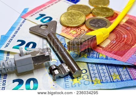 Two Ethernet Connectors Divided By A Key Are Lying On The Euro Banknotes