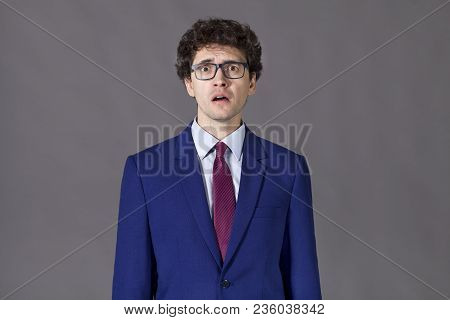 Emotional Guy Wearing Blue Suit. Surprised Businessman