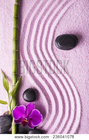 Zen Garden With Sand, Black Stones, Bamboo Branch And Beautiful Purple Orchid
