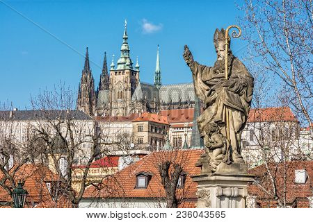 Saint Augustin Statue, Charles Bridge And Prague Castle. Religious Architecture. Travel Destination.