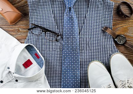 Men Clothes And Accessories Fashion Set. Vest, Necktie, Shirt, Shoes On Wooden Background. Top View