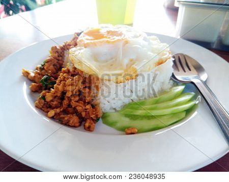 Street Food In Thailand. Rice With Stir-fried Of Chicken And Basil Leaf With Fried Egg Hot And Spicy