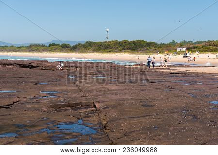 People Enjoying The Sunny Weather On The Beach At Shellharbour, Nsw, Australia