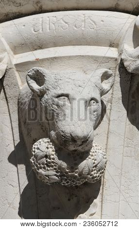 Venice, Italy - July 14, 2016: Detail Of A Statue Of A Bear In A Column In  Saint Mark Square Near T