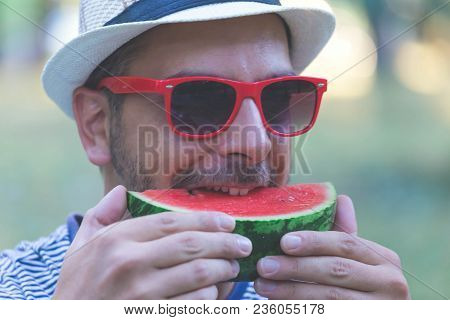 Portrait Of Young Handsome Man Eating Watermelon, Man Holding Watermelon. Close Up Portrait Of A Man